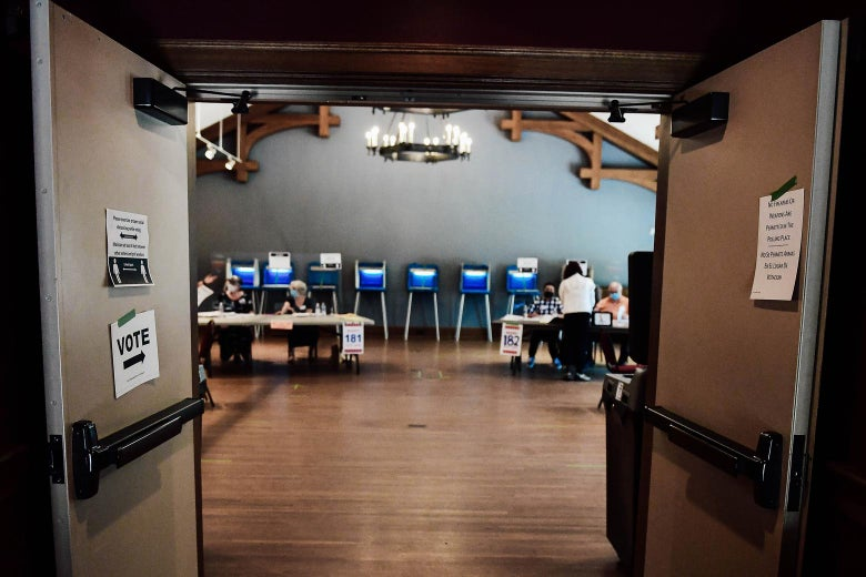 Doors open to a polling site with tables and booths