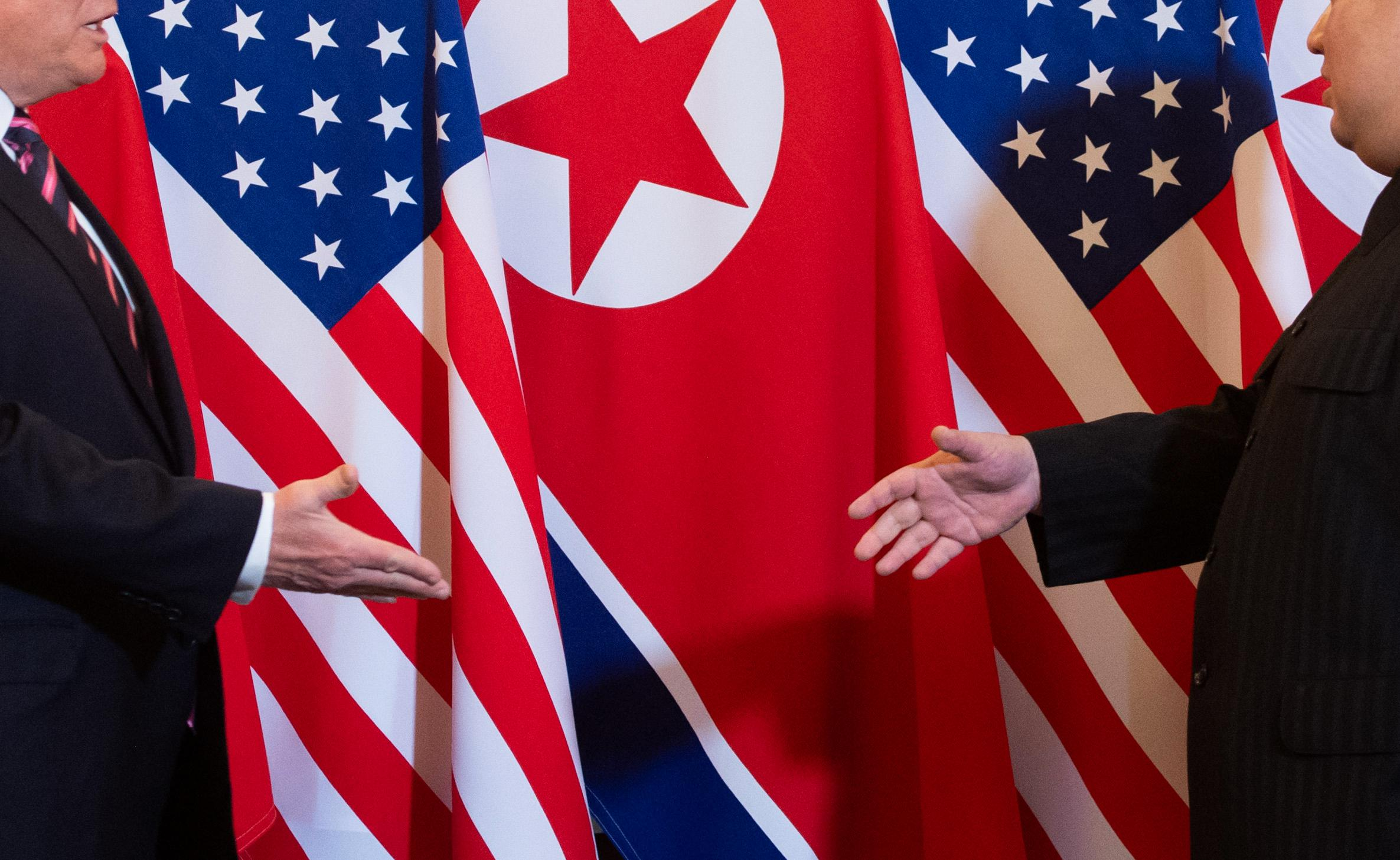 President Trump and Kim Jong-un bringing it in during the summit in Hanoi on Feb. 27, 2019.