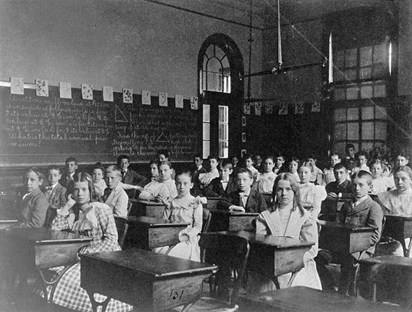 Girls and boys seated at desks in Washington, D.C. classroom, circa 1899.