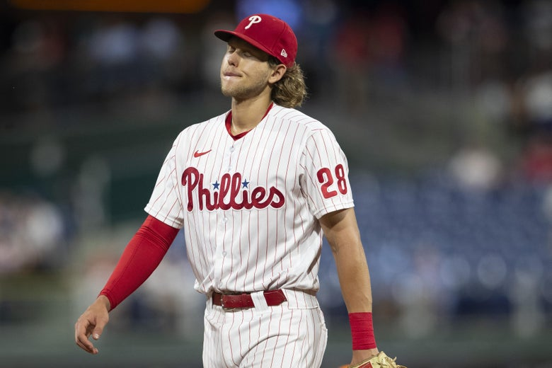 Bohm, in his home Phillies uniform in the field, closes his eyes and grimaces.