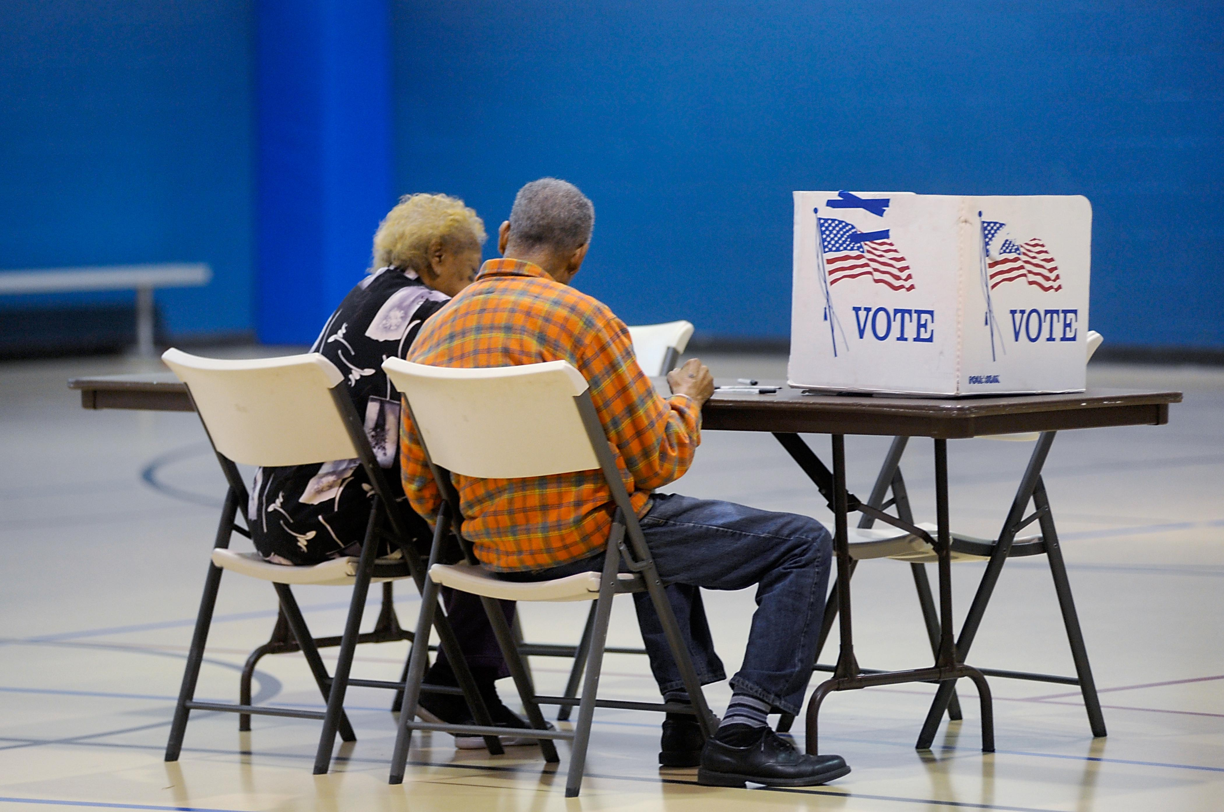 A couple reads a ballot prior to voting on Nov. 8, 2016 in Durham, North Carolina.