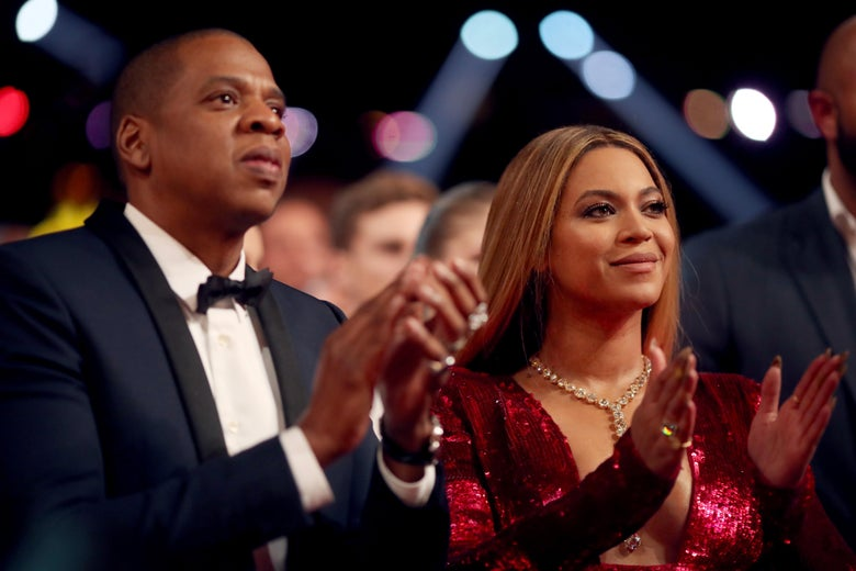 Jay Z (L) and Beyonce attend The 59th GRAMMY Awards at STAPLES Center on February 12, 2017 in Los Angeles, California.  (Photo by Christopher Polk/Getty Images for NARAS)