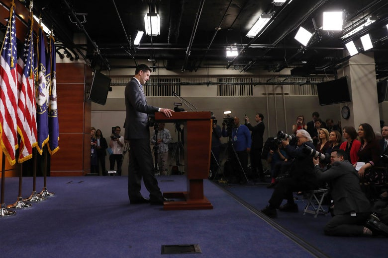 Paul Ryan stands behind a podium.