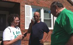 Gail and Steve Koroupis, volunteers with Americans for Prosperity, talk to Leesburg voter Patrick Henry.