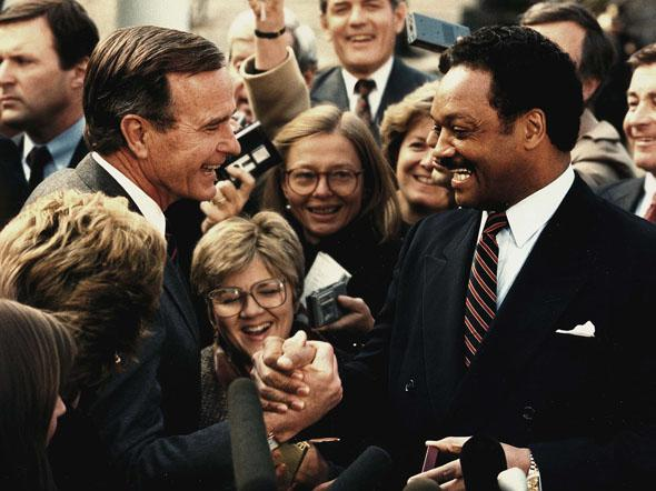 Former president-elect George Bush(L) as shakes hands with the Rev. Jesse Jackson(R), 30 November 1988 after a luncheon meeting at the White House in Washington,DC.