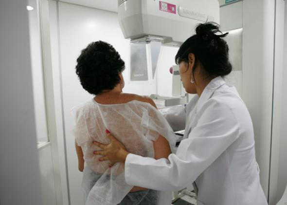 A woman undergoes a free mammogram inside Peru's first mobile unit for breast cancer detection.