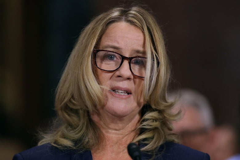 Christine Blasey Ford appears emotional as she speaks before the committee
