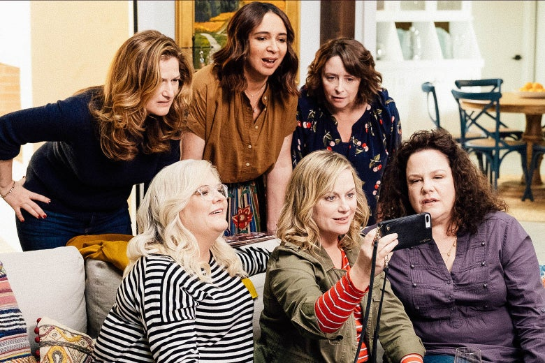 From top left: Ana Gasteyer, Maya Rudolph, Rachel Dratch, Paula Pell, Amy Poehler, and Emily Spivey mug for a selfie in this still from Wine Country.