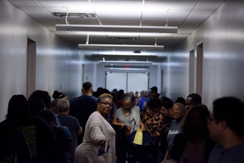 A hallway packed with voters waiting in line.