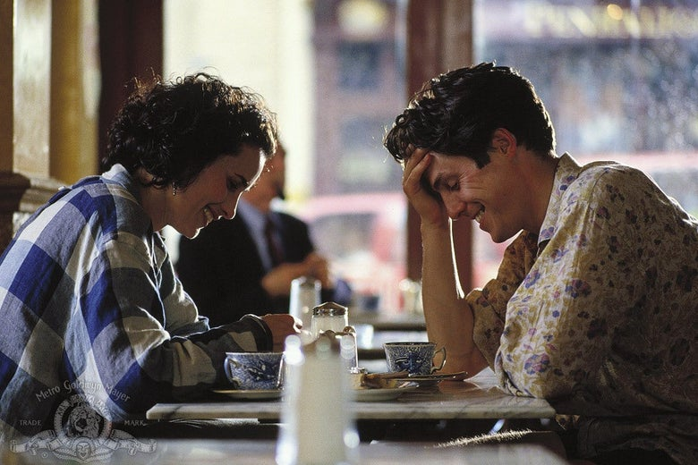 Andie MacDowell and Hugh Grant sit at a table.