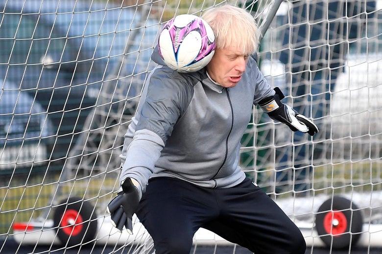 Boris Johnson gets hit in the head with a soccer ball while goalkeeping.