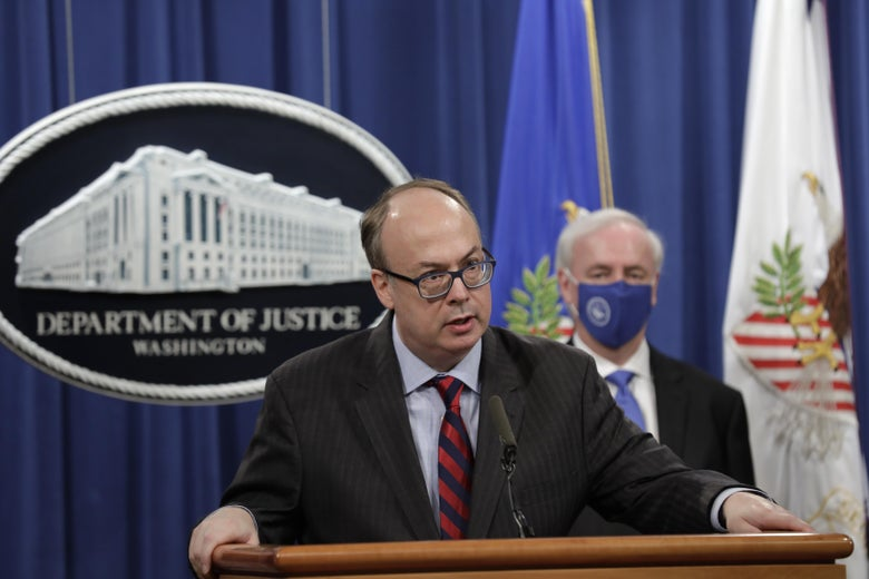 Acting Assistant US Attorney General Jeffrey Clark speaks next to Deputy US Attorney General Jeffrey Rosen at a news conference at the Justice Department in Washington, D.C. on October 21, 2020.