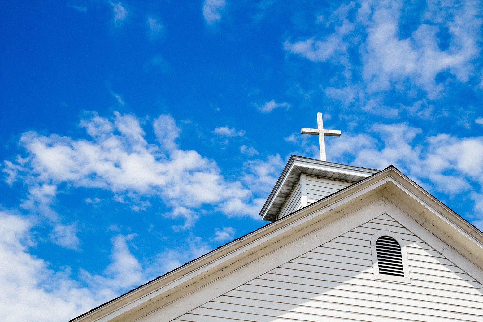 Top of a church against a blue sky.