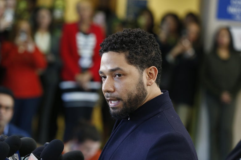 Actor Jussie Smollett stands in front of a microphone at a press conference.