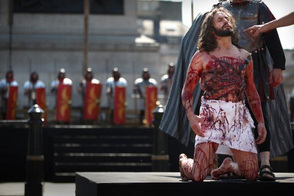 Actors perform the Passion of Jesus in Trafalgar Square on Good Friday