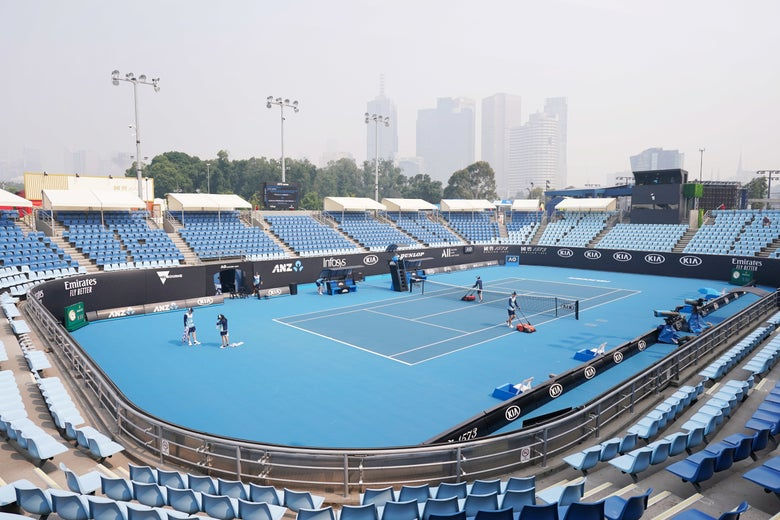 The city skyline shrouded by smoke haze from bushfires during an Australian Open practice session at Melbourne Park in Melbourne, Australia, Jan. 14, 2020.