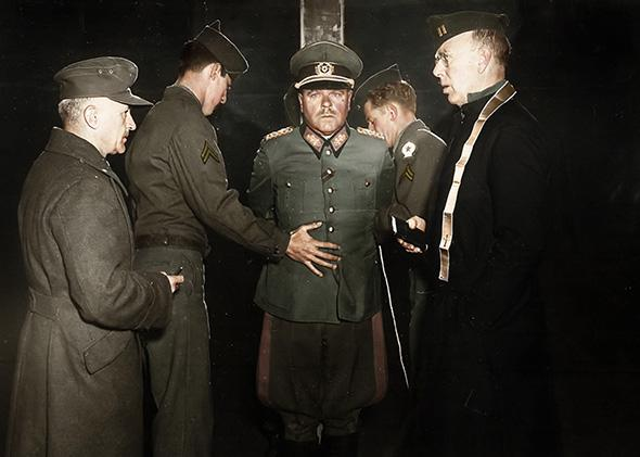 German General Anton Dostler is tied to a stake before his execution by a firing squad in the Aversa stockade, Italy, December 1945.