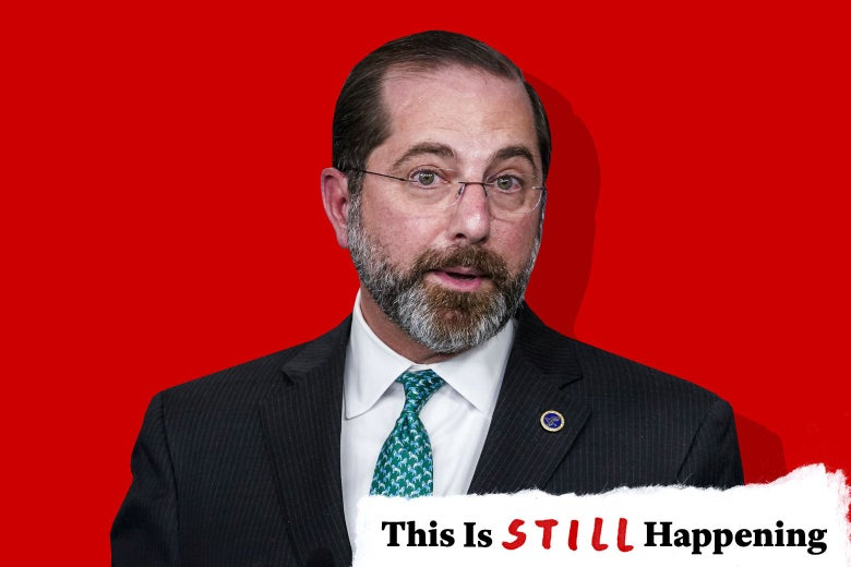 """Alex Azar with a banner that says """"This Is Still Happening."""""""