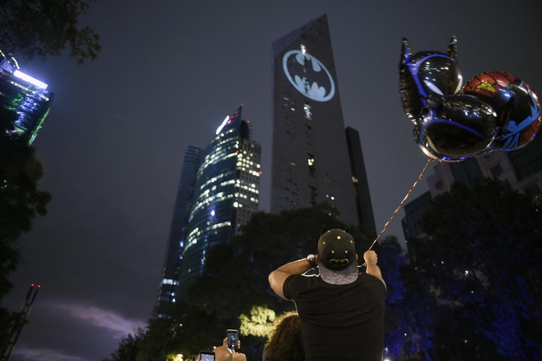 A bat signal projected on the side of a Mexico City skyscraper.