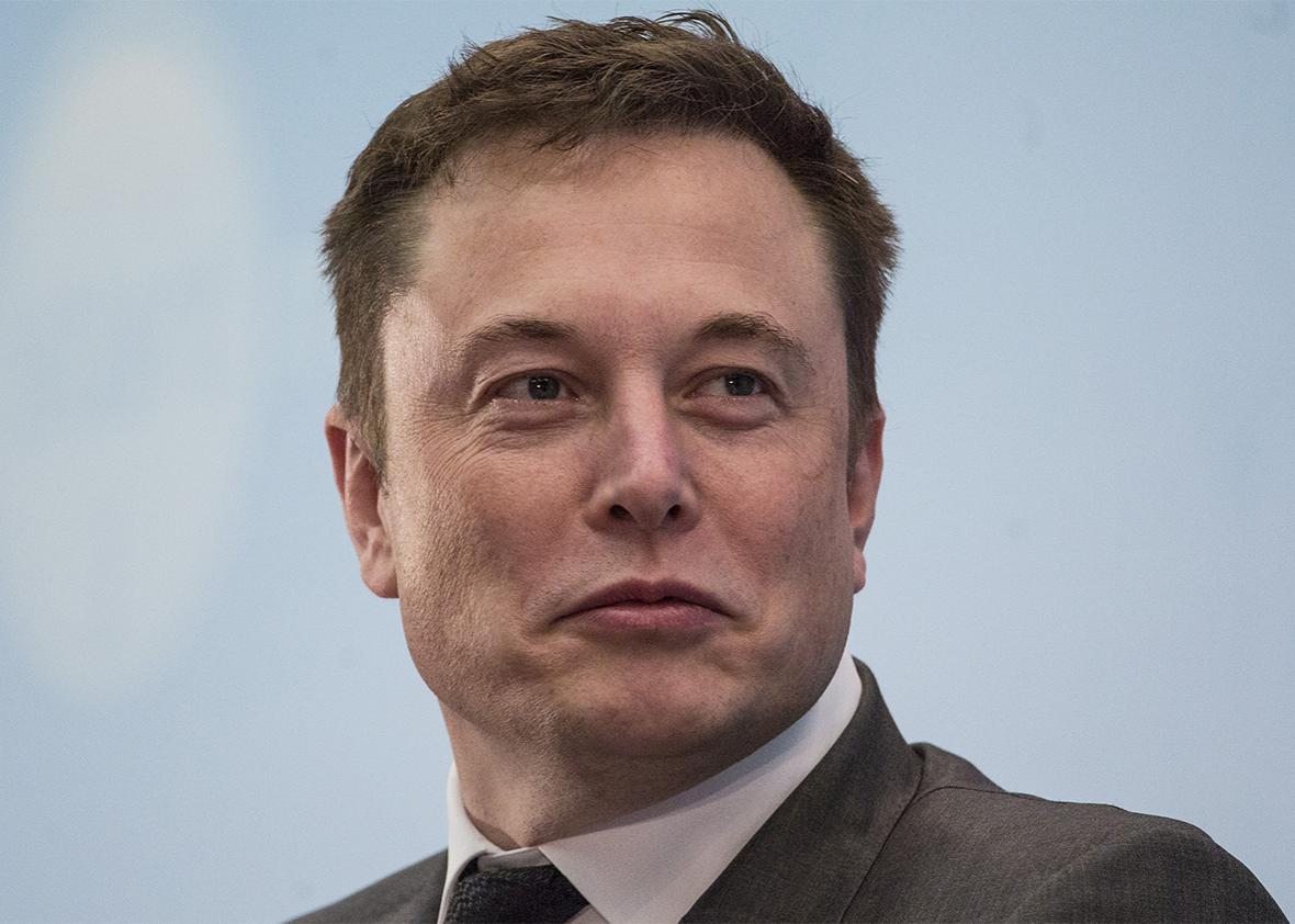 Billionaire Elon Musk, chief executive officer of Tesla Motors Inc., listens during the StartmeupHK Venture Forum in Hong Kong, China, on Tuesday, Jan. 26, 2016.