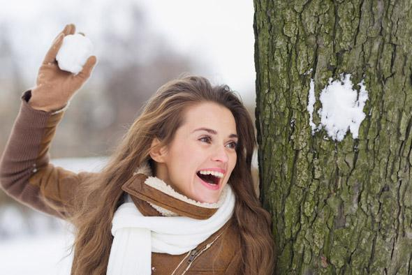 woman in a snowball fight