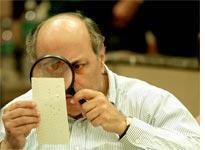 Examining punch ballots in Florida. Click image to expand.