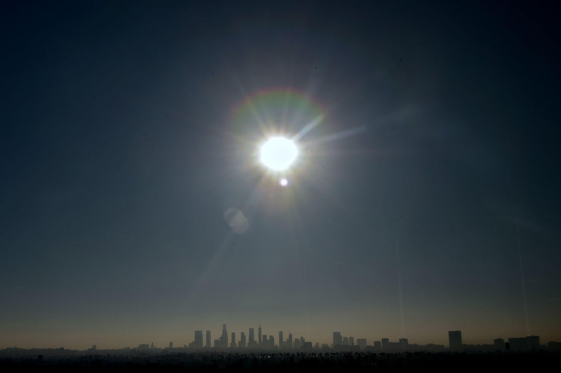 The sun shines over the Los Angeles skyline on January 5, 2018.  A building boom not seen since the 1920's is underway with the construction of new concrete and glass towers. / AFP PHOTO / FREDERIC J. BROWN        (Photo credit should read FREDERIC J. BROWN/AFP/Getty Images)