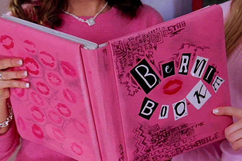 "Hands hold up a pink book that says ""Bernie Book"" on the front."