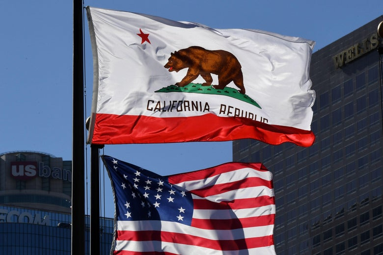 The California State flag flies beside a sign for its sister city Split outside City Hall, in Los Angeles, California on January 27, 2017. A campaign by Californians to secede from the rest of the country over Donald Trump's election is gaining steam with suporters given the green light to start collecting signatures for the measure to be put to a vote.    / AFP / Mark RALSTON        (Photo credit should read MARK RALSTON/AFP/Getty Images)