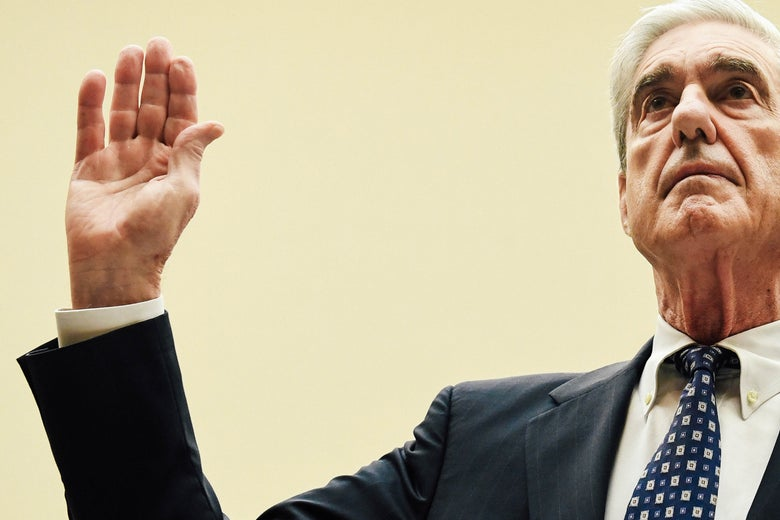 Robert Mueller raises his hand to be sworn in.