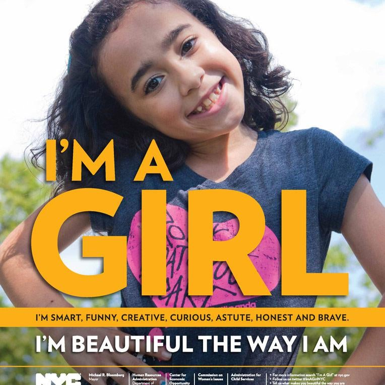 """Poster of a girl smiling with hands on her hips and the slogan """"I'm a girl. I'm beautiful the way I am."""""""