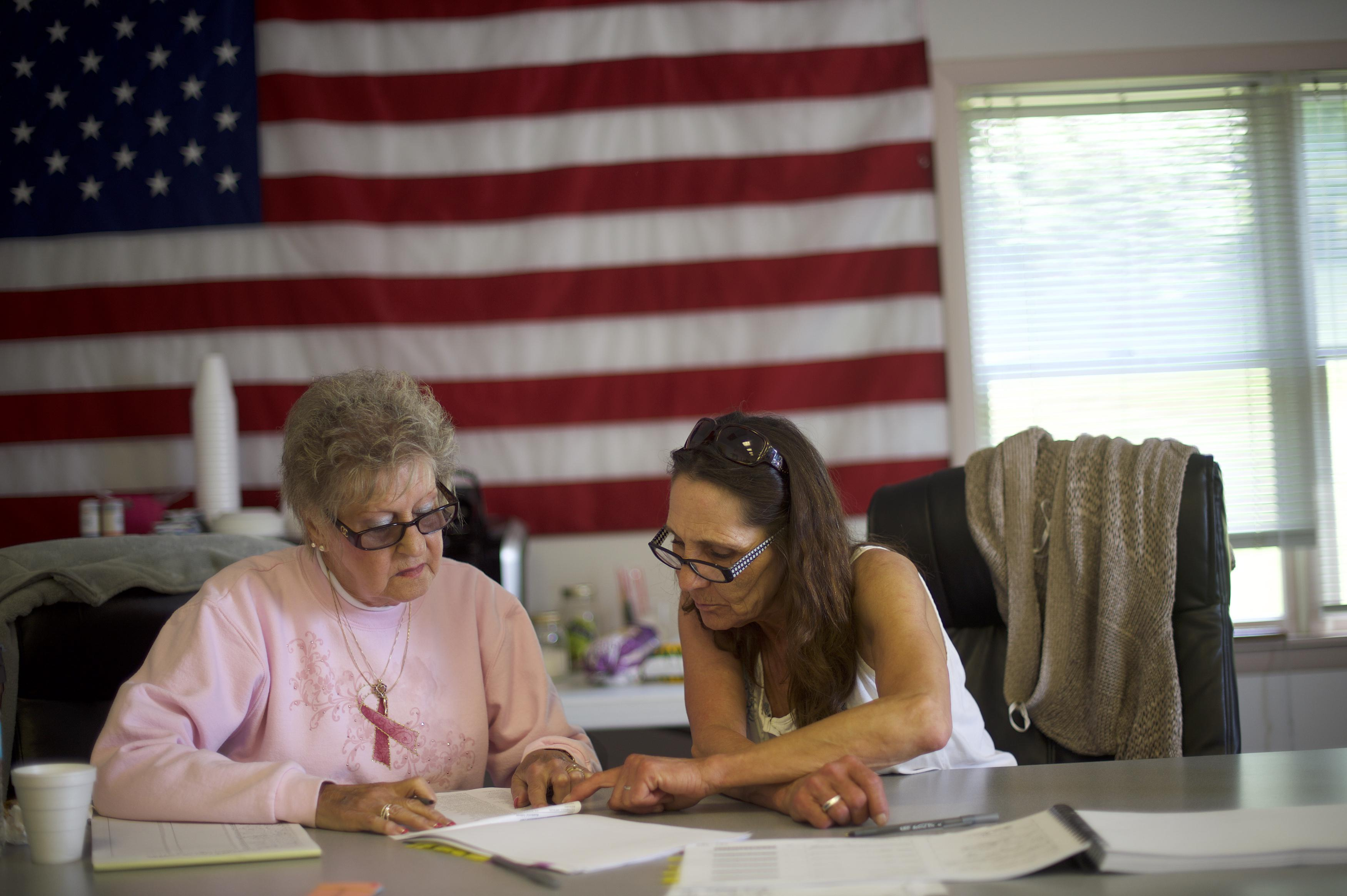 MOCANAQUA, PA - MAY 15:  Election officials (L-R) Barbara Kubasek and Darcie Lapinski confer at the Conyngham Township Municipal Building polling station during the 2018 Pennsylvania Primary Election on May 15, 2018 in Mocanaqua, Pennsylvania.  In the second major May primary day nationwide, four states go to the polls: Idaho, Nebraska, Oregon, and Pennsylvania.  (Photo by Mark Makela/Getty Images)