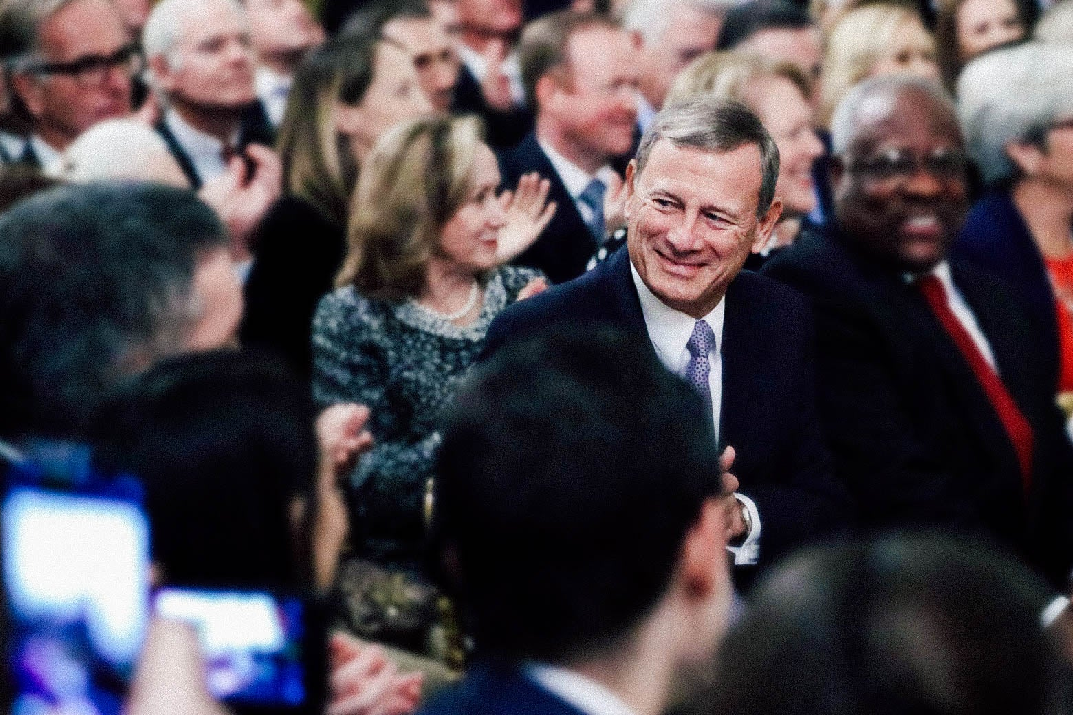 Chief Justice John Roberts and Associate Justices Clarence Thomas and Ruth Bader Ginsburg attend the ceremonial swearing-in of Associate Justice Brett Kavanaugh.