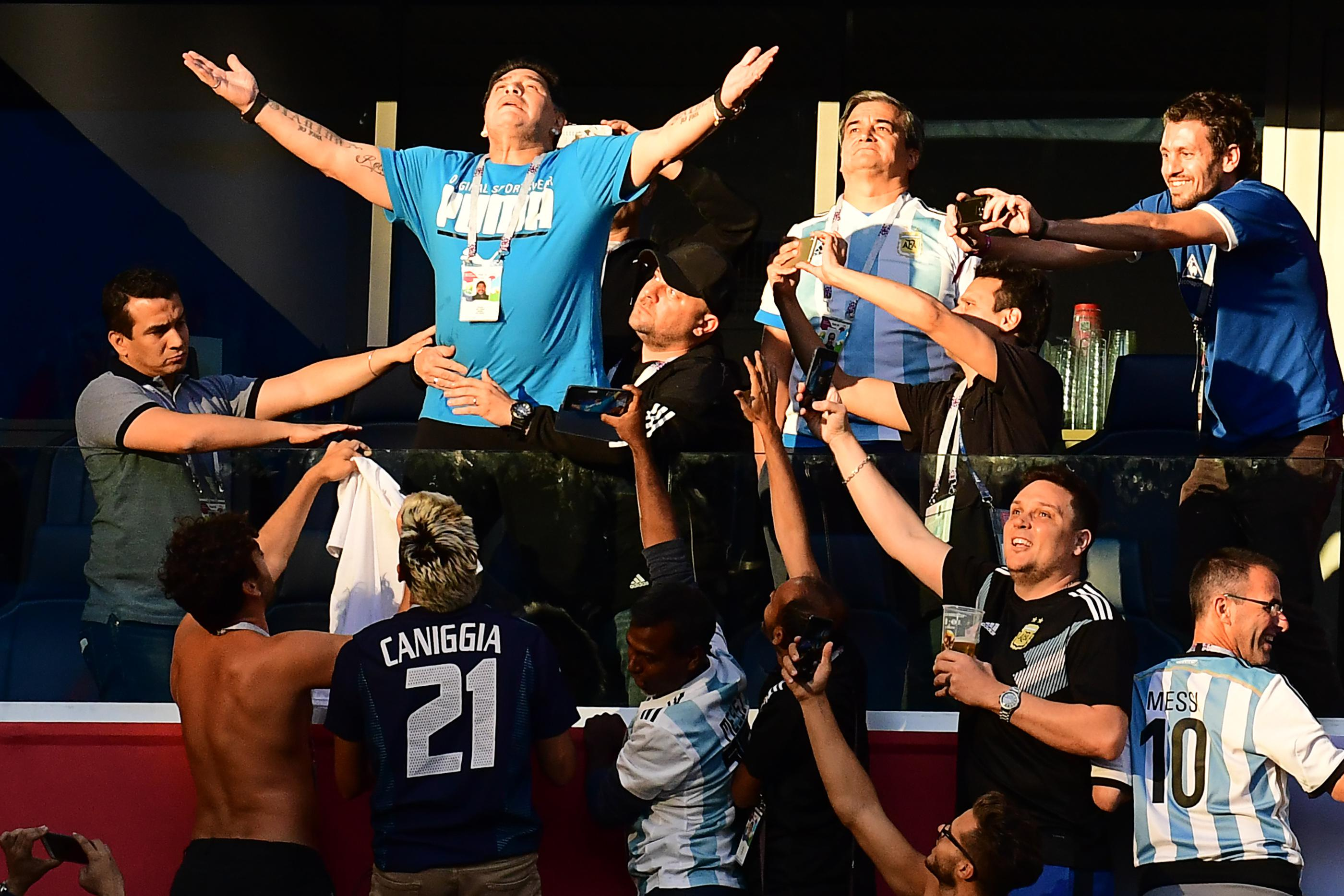 Retired Argentina forward Diego Maradona (2nd-L) poses ahead of the Russia 2018 World Cup Group D football match between Nigeria and Argentina at the Saint Petersburg Stadium in Saint Petersburg on June 26, 2018. - Maradona won the World Cup with Argentina in 1986. (Photo by Giuseppe CACACE / AFP) / RESTRICTED TO EDITORIAL USE - NO MOBILE PUSH ALERTS/DOWNLOADS        (Photo credit should read GIUSEPPE CACACE/AFP/Getty Images)