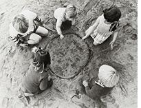 Children playing marbles. Click image to expand.