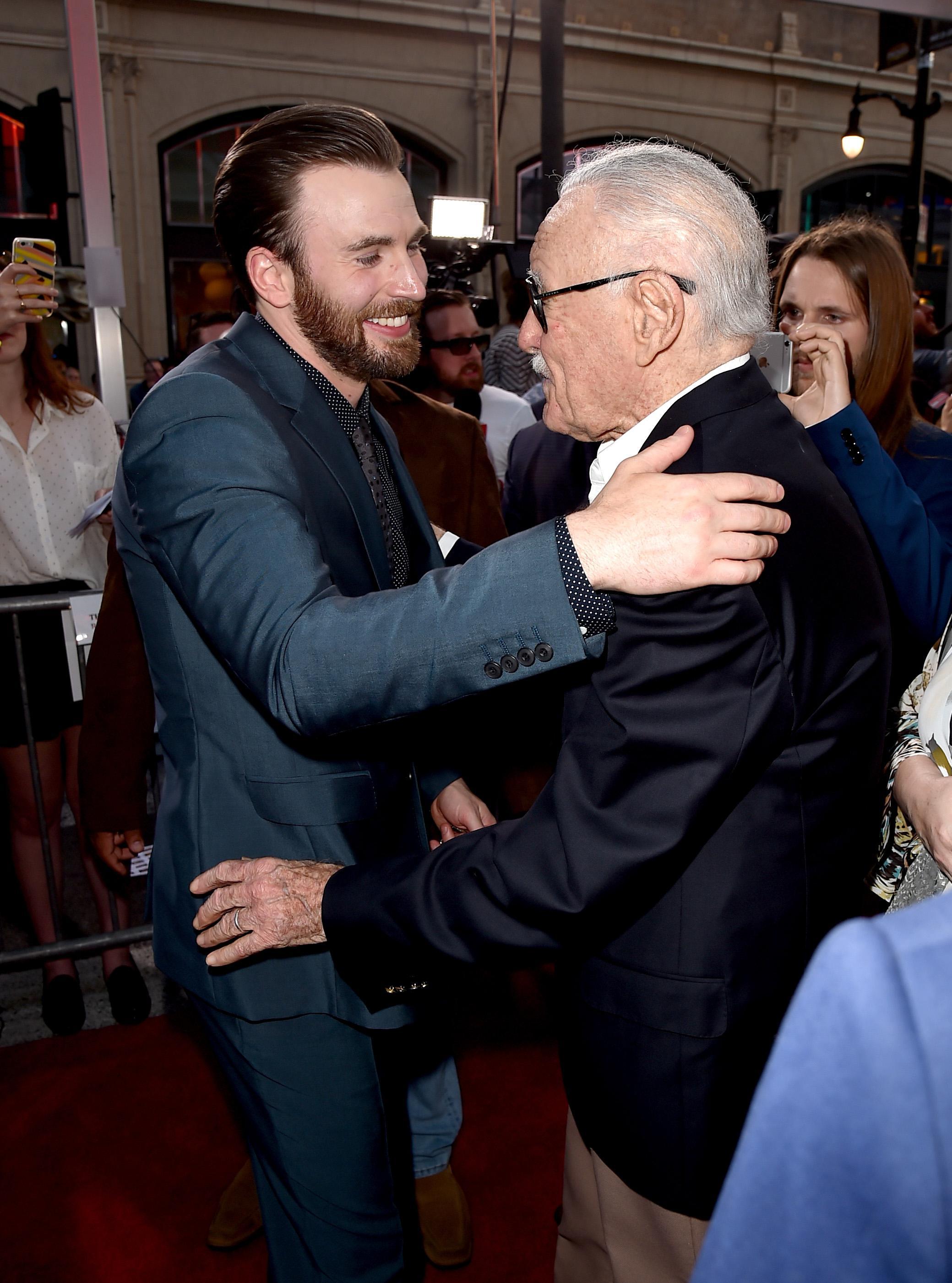 Chris Evans embracing Stan Lee.