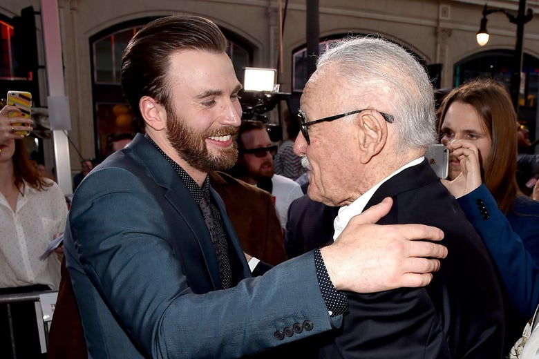 Chris Evans embracing Stan Lee.
