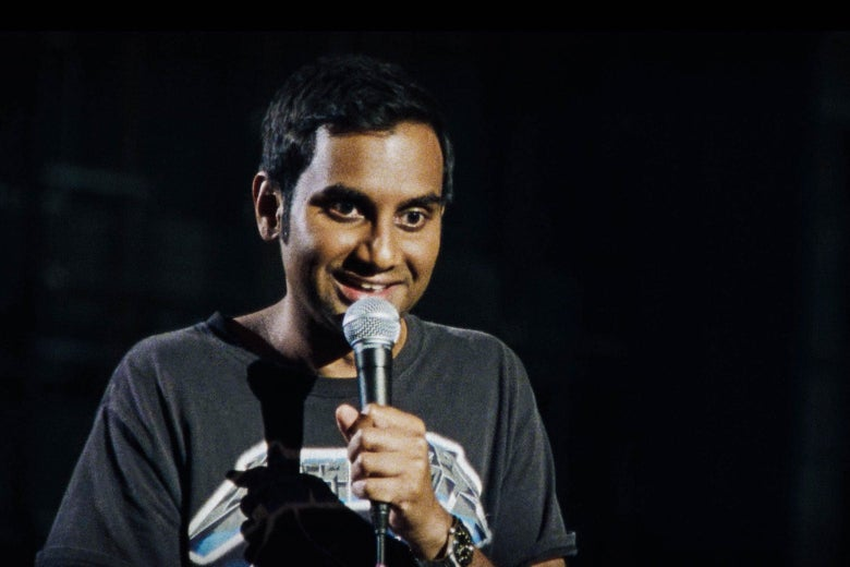 Aziz Ansari in his Right Now stand-up clothes: a Metallica T-shirt and jeans.