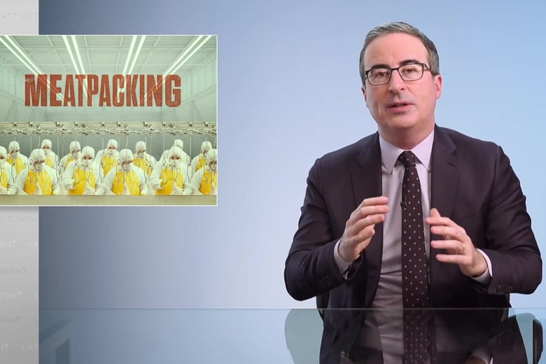 """John Oliver sits behind a glass-topped anchorman desk; a graphic reading """"MEATPACKING"""" is displayed behind him."""