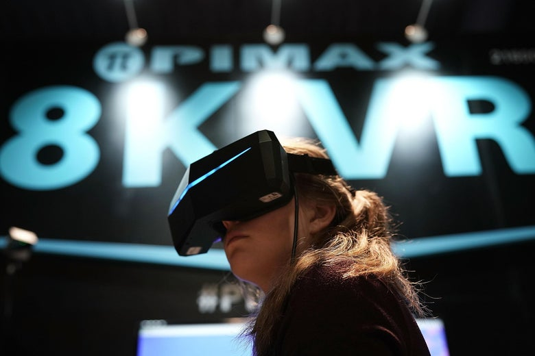 LAS VEGAS, NV - JANUARY 10:  A woman participates in an 8K VR experience during CES 2018 at the Las Vegas Convention Center on January 9, 2018 in Las Vegas, Nevada. CES, the world's largest annual consumer technology trade show, runs through January 12 and features about 3,900 exhibitors showing off their latest products and services to more than 170,000 attendees.  (Photo by Alex Wong/Getty Images)