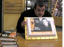 """Mark Billingham with his """"face"""" cake"""