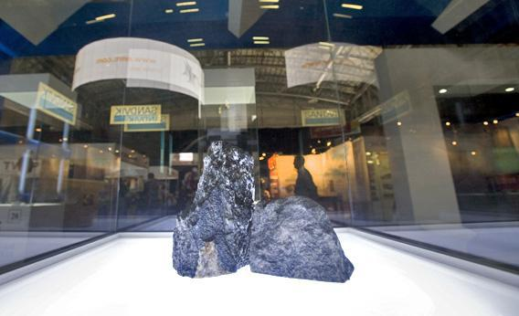 Two pieces of platinum ore are displayed at the Investing in Africa Mining Indaba in February 2012 in Cape Town.