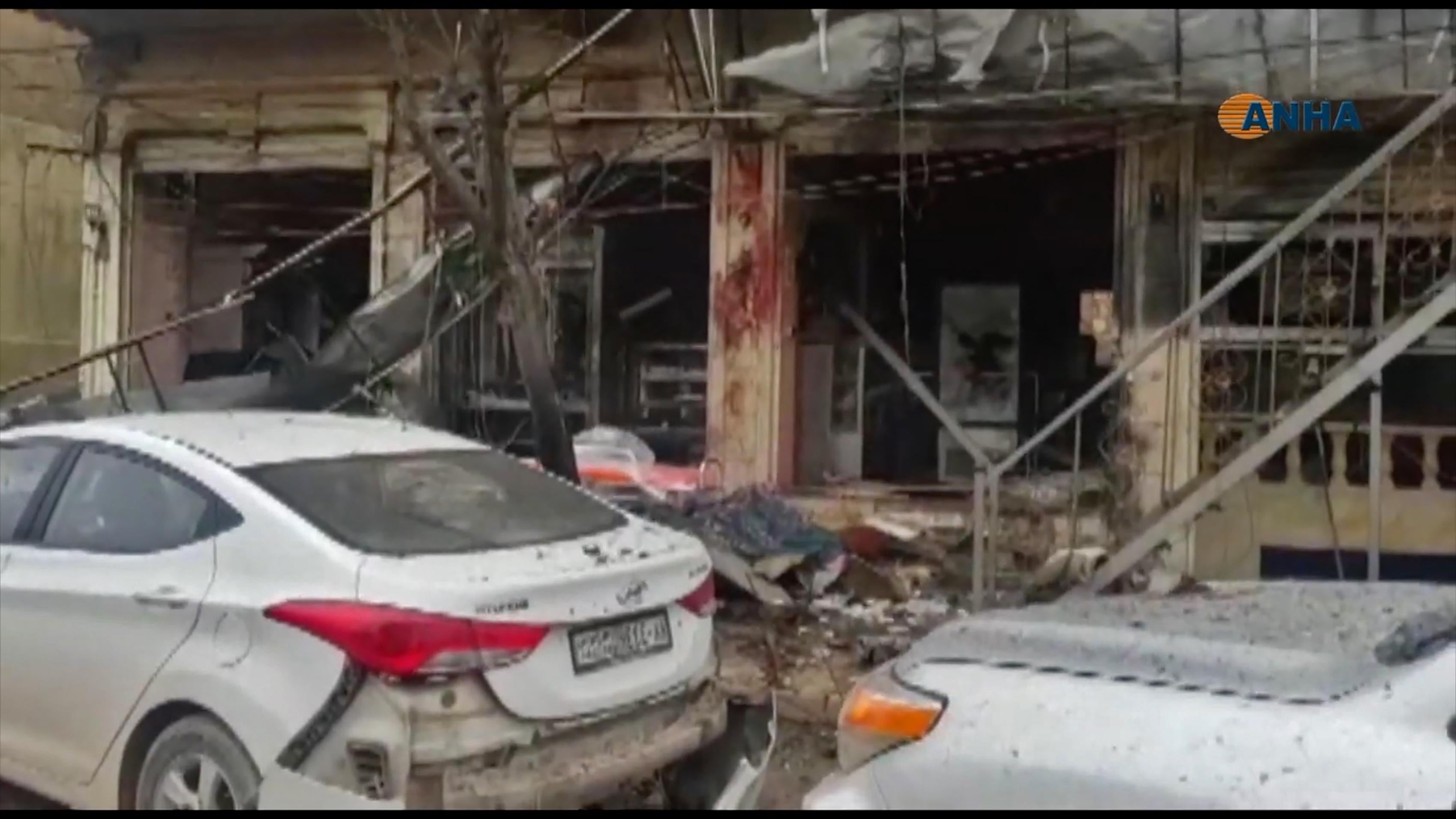 An image grab taken from a video published by Hawar News Agency (ANHA) on January 16, 2019, shows the aftermath of a suicide attack in the northern Syrian town of Manbij.