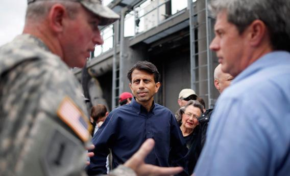 Louisiana Governor Bobby Jindal and Sen. David Vitter (R-LA) receive an update during Hurricane Isaac.