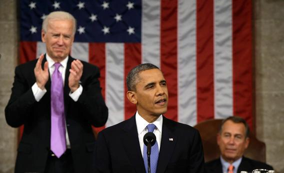 Vice President Joe Biden, left, applauds as President Obama gives his State of the Union address during a joint session of Congress at the U.S. Capitol, Feb. 12, in Washington, D.C.