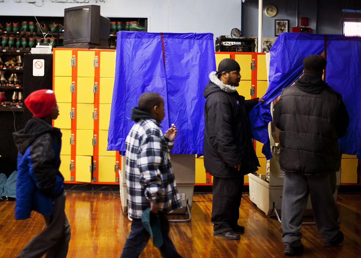 Residents cast their ballots at a polling place inside the Elmwood Roller Skating Rink on November 6, 2012 in Southwest Philadelphia, Pennsylvania.