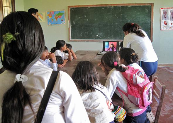 Bolivian students working with a computer in the classroom, November 25, 2010.