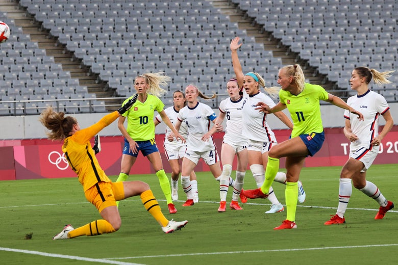 Blackstenius fires past the American goalie as the rest of the U.S. defenders look on, empty stands in the background