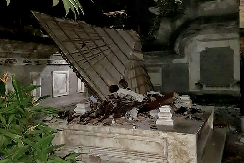 A Balinese temple is seen partially collapsed in Badung in Bali island on August 5, 2018 after a major earthquake rocked neighboring Lombok island.