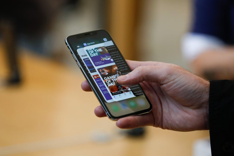 An Apple employee demonstrates the app switcher on the new iPhone X at the Apple Store Union Square on November 3, 2017, in San Francisco, California.         Apple's flagship iPhone X hits stores around the world as the company predicts bumper sales despite the handset's eye-watering price tag, and celebrates a surge in profits. / AFP PHOTO / Elijah Nouvelage        (Photo credit should read ELIJAH NOUVELAGE/AFP/Getty Images)